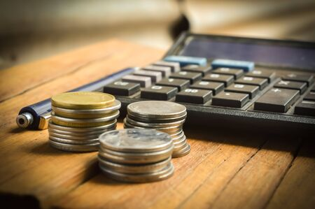 coins and calculate and other items on table,top view of Businessan Banco de Imagens