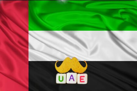uae real texture flag,uae flag and text written UAE on mustaches meaning strong,waving fabric texture of the flag with color of united arab emirates,United Arab Emirates flag