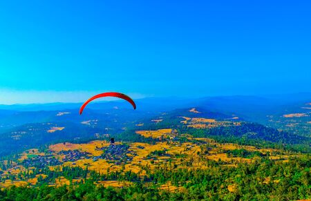 Paragliding in the sky,Paragliding for the first time it appears here, Extreme sport,paragliding,saputara hill station paragliding Stock Photo