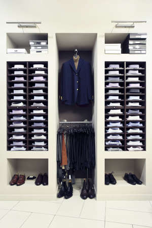 garment: Mens clothes and shoes in modern shop interior