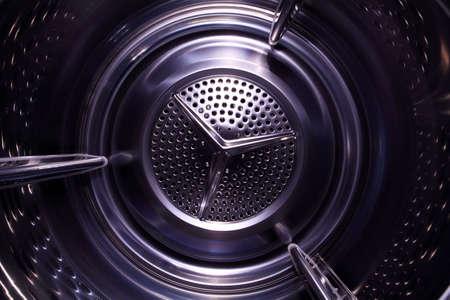 Illusory space inside washingdrying machine photo