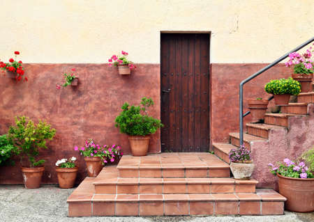 wooden doors: Mediterranean style house entrance