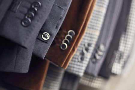 Detail of mens jackets line in a shop, DOF photo
