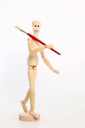 Wooden dummy with red brush photo
