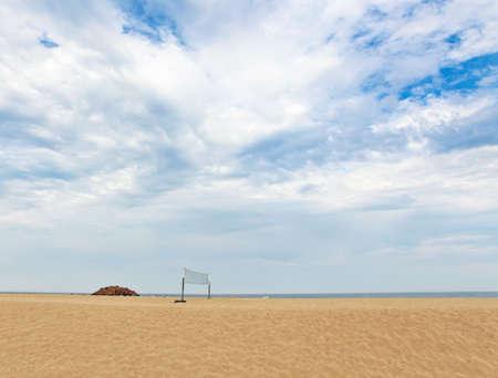 Beach volleyball net on empty pitch  photo