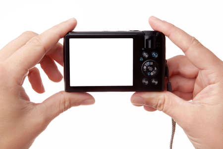 Hands holding digital photo camera with free space for your image photo