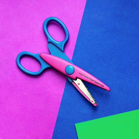 Colorful paper with child's scissors Stock Photo - 8052156