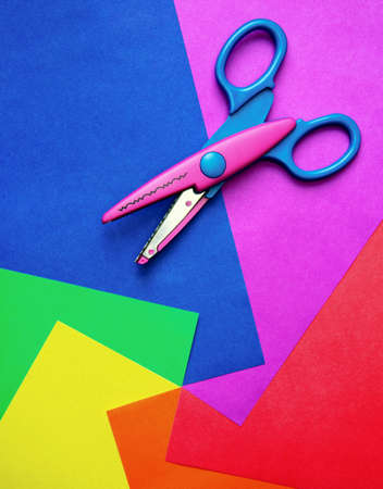 Colorful paper with child's scissors Stock Photo - 8052160