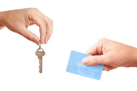 Buying or renting real estate - hands isolated on white photo