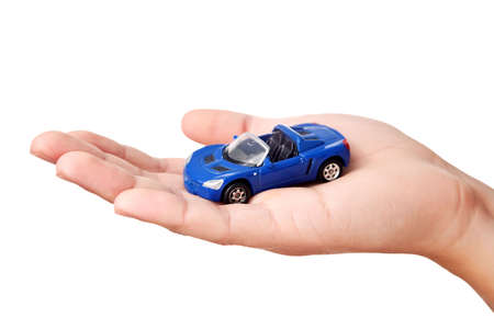 lease: Hand holding small blue car, isolated on white