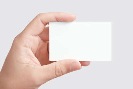 business card hand: Hand holding blank business card, a set of 4 colored backgrounds