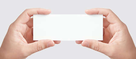 Two mans hands holding long blank paper business card, copy space fot your message or adverisment photo