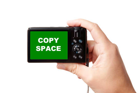 Closeup image of hand, holding modern compact digital photo camera, isolated on white background, with easy to cut-out green display - copy space for your picture or text photo