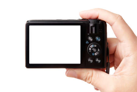 filming point of view: Closeup image of hand, holding modern compact digital photo camera, isolated on white background, with easy to cut-out green display - copy space for your picture or text