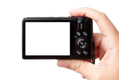 point and shoot: Imagen de detalle de mano, sosteniendo la c�mara moderna fotograf�a digital compacto, aisladas sobre fondo blanco, con f�cil a verde visualizaci�n de desconexi�n - espacio de copia de la imagen o el texto