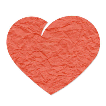 Red heart shape, isolated on white background, cut out from grungy crumpled package paper photo
