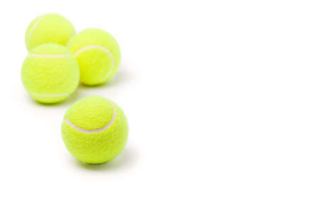 Four classic tennis balls isolated on white background photo