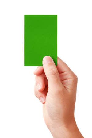 arbitro: Mano de un juez que muestra decisi�n positiva s�mbolo - tarjeta verde, aislado en blanco  Foto de archivo
