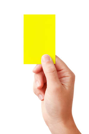 arbiter: Hand of a judge showing warning symbol - yellow card, isolated on white background  Stock Photo