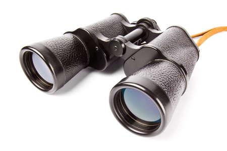 Old antic binocular coated with black leather, isolated on white background  photo