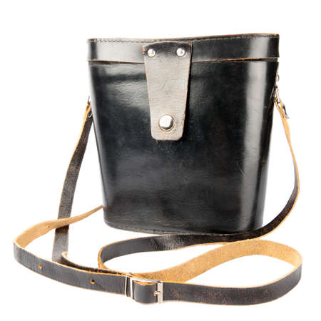 Antic black natural leather shoulder bag (binocular case) with long carrying strap, isolated on white background  photo