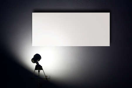 spotlight background: Small spotlight lighting blank white advertisement board on the wall  Stock Photo