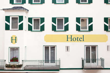 Hotel, detail of facade - traditional Alpine architecture, simple classic stile, easy to change title board   photo