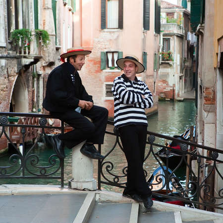 Venice, Italy, September 30, 2010 - Two gondoliers having rest in Venice