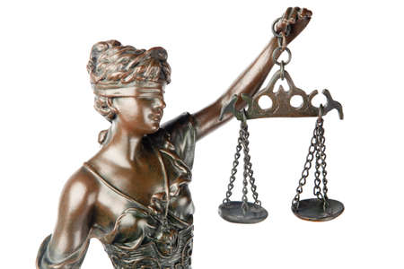 law scale: Closeup of a sculpture of Themis, mythologic greek godness, symbol of justice, blind and holding empty balance in her hand, isolated on white backgroung