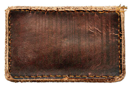 Blank grungy brown natural leather jeans label, highly detailed, isolated on white background Stock Photo
