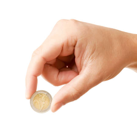 Mans hand, holding 2 EURO coin, isolated on white background photo