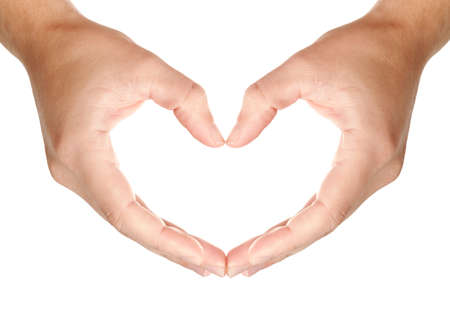 Mans hands held in protecting hearts shape, showing love and care symbol, isolated on white background, may use as a copy space for your object or text Stock Photo