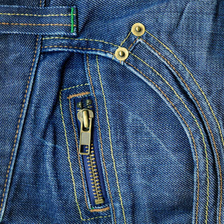 zip: Closeup of denim background with metal zipper Stock Photo