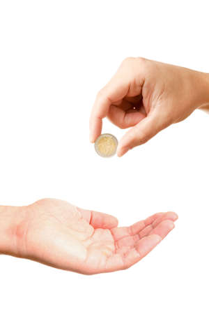 Closeup of mans hand giving two euros coin to other asking man hand, isolated on white background photo