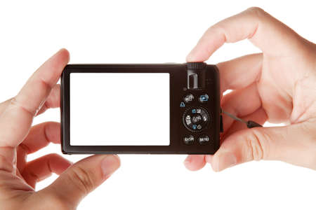 free background: Hands holding digital photo camera with free space for your image, isolated on white background