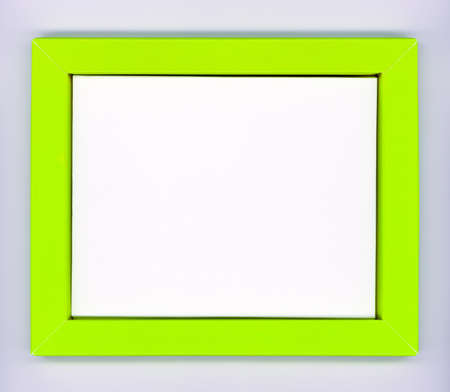 Empty green paper frame with white background on gray wall Stock Photo - 9893230