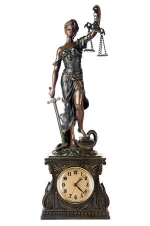 antique woman: Concept of time for Justice: Themis, mythological Greek goddess, symbol of justice, blind and holding empty balance in one hand and sword in another, standing on defezted snake and book, as a table clock, isolated on white background  Stock Photo