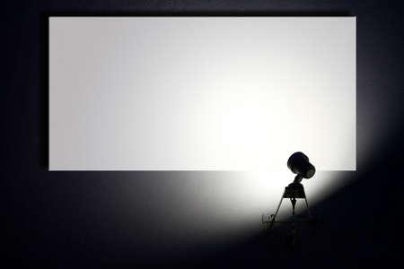 Small spotlight lighting blank white advertisement board on the wall
