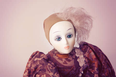Womans beauty concept - vintage porcelain lady doll with beautiful make-up on her face photo