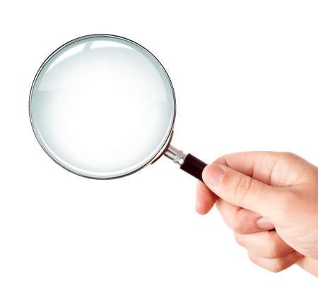 Hand of a man holding magnifying glass