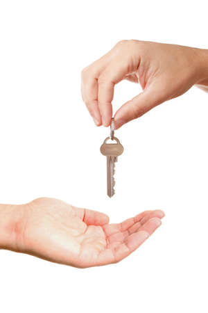 Hands of two people, giving and taking modern key, isolated over white background photo