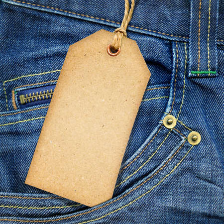zip: Vintage paper tag on blue denim