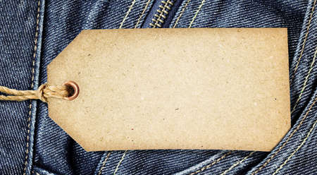 Vintage paper tag on blue denim Stock Photo - 10529474