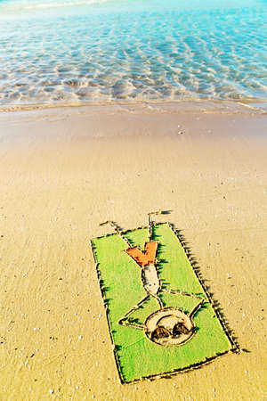 Fun in the sun concept - funny cartoon laying on a towel and having sun bath on the tropical beach photo