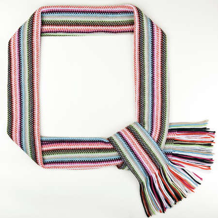 Funny christmass frame made of warm scarf Stock Photo