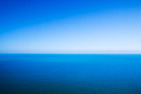 tranquil scene: Idyllic abstract background - horizon line between calm sea and clear blue sky
