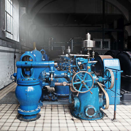 Heavy water pumping machinery in vintage industrial water cleaning station Editorial