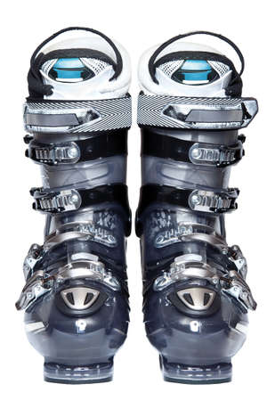 Modern professional ski boots isolated over white background photo