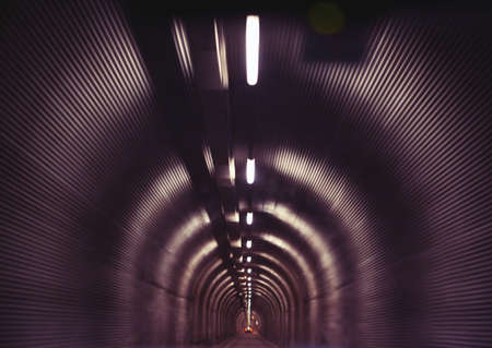 Motion blurred narrow old tunnel between Italy and Switzerland, Europe photo