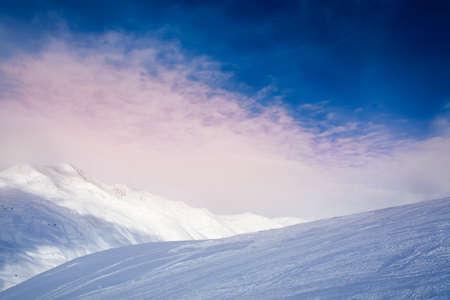 Panorama of sunrise over winter mountains photo